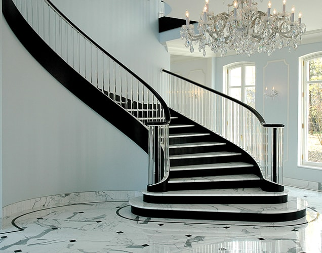 This Circular Staircase Features Marble Treads Gl Baers Stacked Half Circle Starting Descending Stringer Drums And Custom Floor Borders
